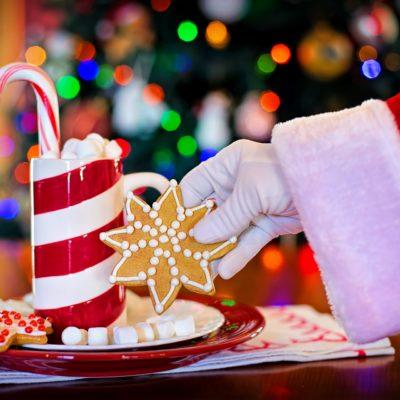 santa claus reaching for a cookie